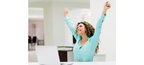 Businesswoman holding her arms up in celebration, happy about how Keen Decision Systems is helping her business excel