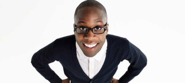 Happy marketer with glasses optimistic about the ways Keen Decision Systems can drive his marketing decisions