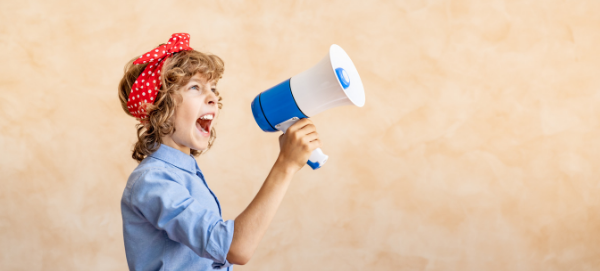 Young woman shouting through a megaphone