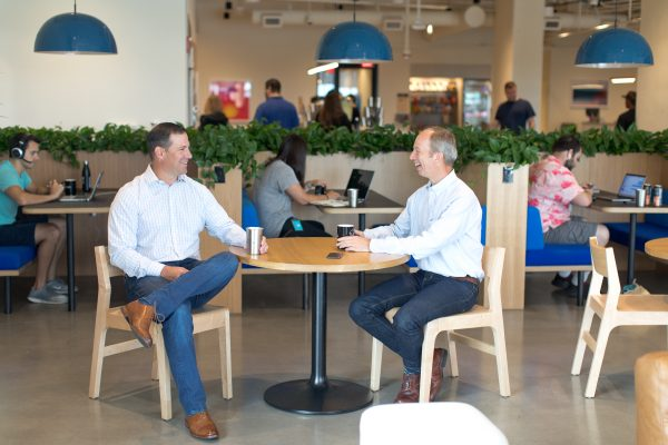 Keen's Greg Dolan (CEO and Co-Founder) and John Busbice (Chief Product Officer and Co-Founder) chat in a cafe