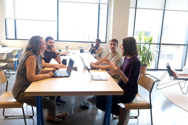 The Keen team working at a conference table